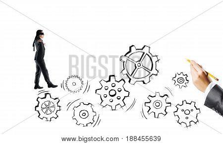 Young businessman walking forward on drawn gears mechanism