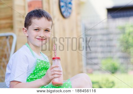 Child Drinking Strawberry Banana Cocktail