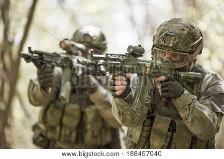 Two officers in military intelligence at forest