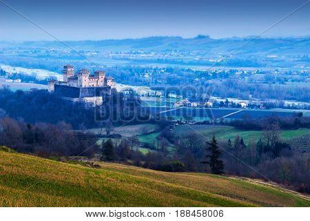 Night landscape with Torrechiara castle in Emilia-Romagna region Italy.