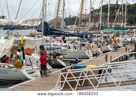 FUNCHAL MADEIRA PORTUGAL - SEPTEMBER 8 2016: Yachts moored in Funchal seaport Madeira island Portugal