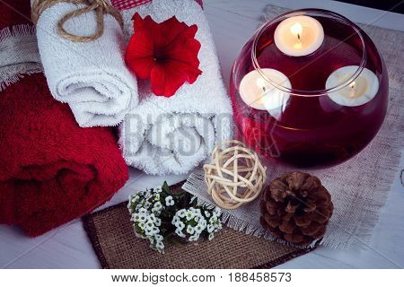 SPA consist from towels, candles, flowers, and aromatherapy water in a glass bowl