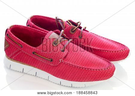 red leather moccasins on a white background, isolated