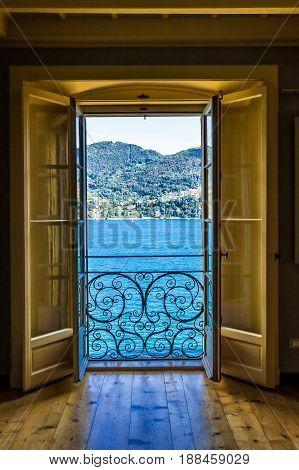 Picturesque View Of Como Lake Through The Doorway
