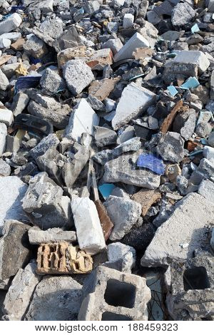 Broken concrete blocks and bricks. Construction debris. poster