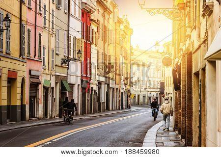 Sunny street in Parma Emilia-Romagna Italy. Old architecture.