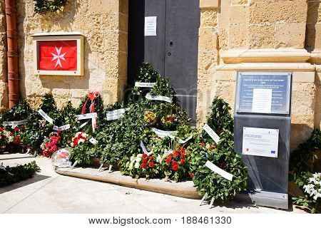 VALLETTA, MALTA - MARCH 30, 2017 - Floral tributes outside the Church of Our Lady of Victory in Castille Square Valletta Malta Europe, March 30, 2017.