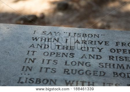 Lisbon, Portugal - july 2016: Close-up of Poem Engraved on Bench inside Castle of Sao Jorge in Lisbon Portugal