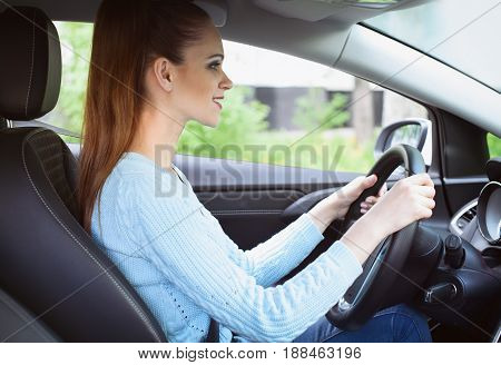 Young Smiling Girl Driving A Car
