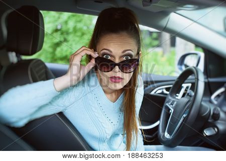 Shocked Young Woman In The Car