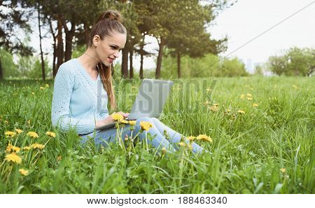 Young Pretty Girl Working On Laptop Outdoors