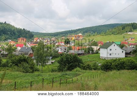 Modern cottages on of forested mountains. Carpathians Ukraine