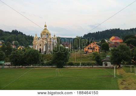 Panorama of Schodnica on of forested mountains. Carpathians Ukraine