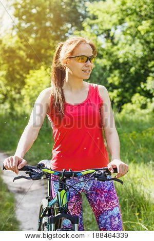 Sports Woman In The Sportswear With A Sport Bicycle