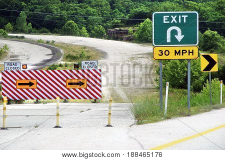 photography with scene of the traffic signs beside locked road