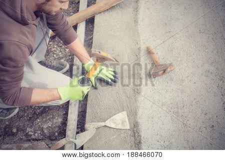 Renovating concrete pavement in home / budget DIY version.