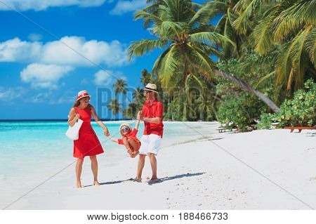 happy family with kid playing on tropical sand beach