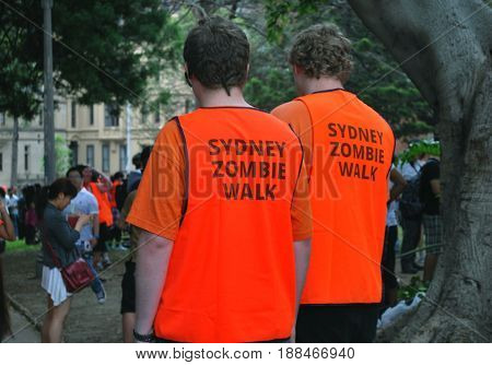 SYDNEY AUSTRALIA - NOVEMBER 02 2013: Volunteer attendants watching preparations for Sydney Zombie Walk at Hyde Park. It is an annual event where thousands of people get involved to raise awareness for Australia's Brain Foundation.