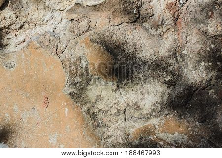Abstract texture of plaster surface used in design projects of premises. The wall background is the result of exposure to the environment- rain and time.