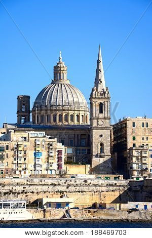 VALLETTA, MALTA - MARCH 30, 2017 - View of St Pauls Anglican Cathedral and the Basilica of Our Lady of Mount Carmel seen from the Grand Harbour Valletta Malta Europe, March 30, 2017..