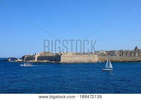 VALLETTA, MALTA - MARCH 30, 2017 - View of Fort St Elmo and city buildings seen across the Grand Harbour from Sliema Valletta Malta Europe, March 30, 2017.