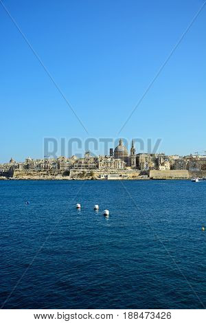 VALLETTA, MALTA - MARCH 30, 2017 - View of St Pauls Anglican Cathedral and the Basilica of Our Lady of Mount Carmel seen from the Grand Harbour Valletta Malta Europe, March 30, 2017.