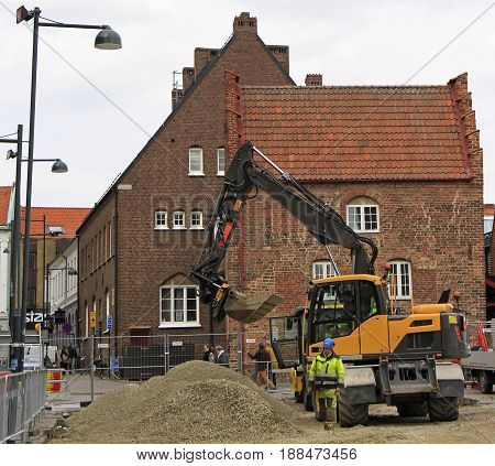 Lund, Sweden - April 21, 2017: street workers are reconstructing one of squares in Lund, Sweden