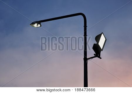 Background silhouette of Electric poles provide light. Concept - guidehopequietlonelyLife