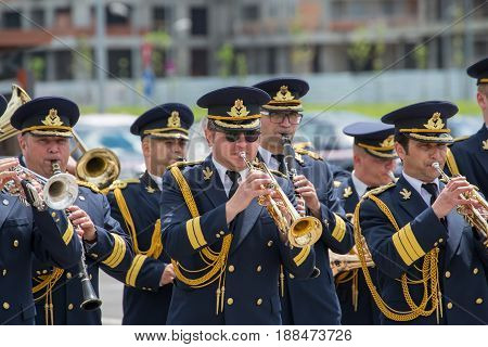 Brasov, Romania - 28 May, 2017: The Romanian National fanfare singing outdoors with the occasion of aeronautical show and presentation of old planes