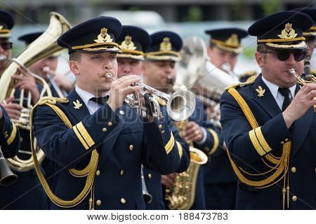Brasov, Romania - 28 May, 2017: The Romanian National fanfare singing outdoor with the occasion of aeronautical show and presentation of old planes