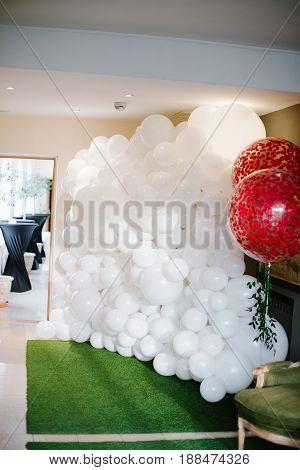 Magic baloons decor of photo zone for wedding ceremony