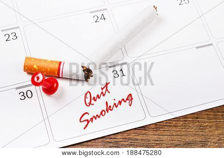 Closeup Of Broken Cigarette Lying On Month Calendar. World no tobacco day concept.