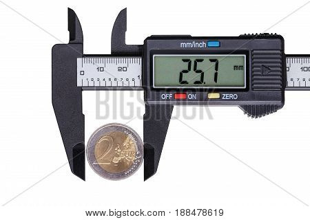 The digital caliper measures a coin with a face value of two euros. Objects isolated on white background