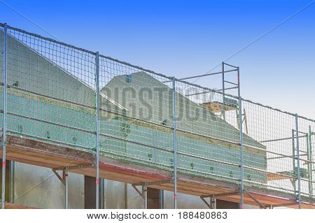 The construction of a settlement with turnkey prefabricated houses. Prefabricated house under construction