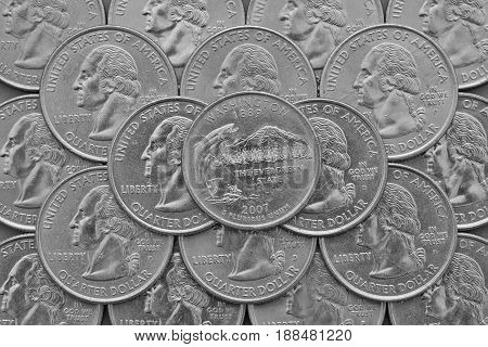 Washington State and coins of USA. Pile of the US quarter coins with George Washington and on the top a quarter of Washington State.