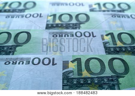 abstract unsharp background a collage from money and currency or from paper banknotes in hundred euros closeup