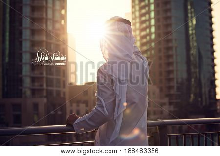Arabic man waiting for Ramadan in Dubai ( Ramadan Kreem Arabic text )