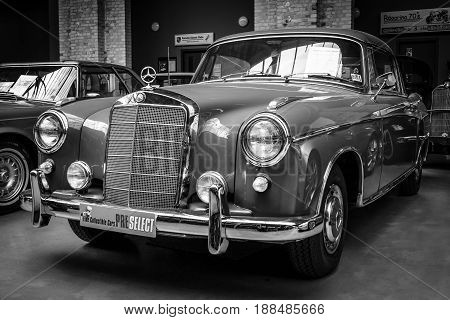 BERLIN GERMANY - MAY 17 2014: Full-size luxury car Mercedes-Benz 220S Coupe (W111). Black and white. 27th Oldtimer Day Berlin - Brandenburg