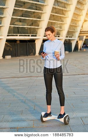 Businesswoman on a hoverboard. Female with cup and phone. Time management tips.