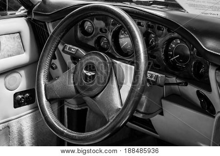 BERLIN GERMANY - MAY 17 2014: Interior of the driver's seat of the car Aston Martin V8 Volante. Black and white. 27th Oldtimer Day Berlin - Brandenburg