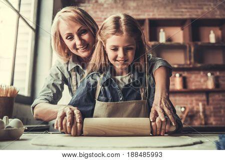 Grandma And Granddaughter In Kitchen