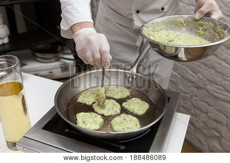 Cooking pancakes. The chef pours the batter onto a hot frying pan