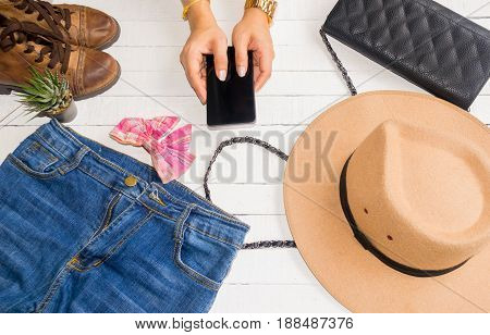 Accessories clothes fashion set jeans bags shoes hat and Smartphone buy online on a white background.