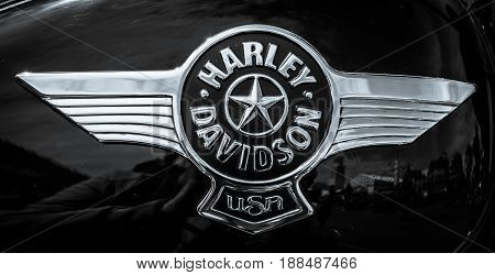 BERLIN GERMANY - MAY 17 2014: The emblem on the fuel tank of motorcycle Harley Davidson Softail. Black and white. 27th Oldtimer Day Berlin - Brandenburg