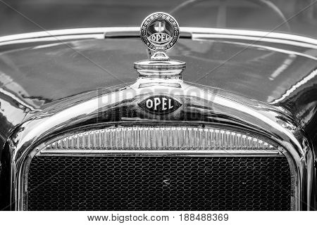 BERLIN GERMANY - MAY 17 2014: Hood ornament of the Opel 1.2-litre Cabrio-Limousine (1934). Black and white. 27th Oldtimer Day Berlin - Brandenburg