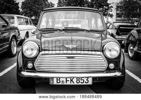 BERLIN GERMANY - MAY 17 2014: Small economy car Austin Mini Cooper. Black and white. 27th Oldtimer Day Berlin - Brandenburg