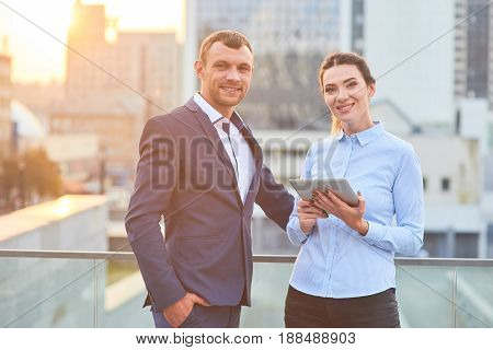 Smiling business couple outdoor. Young caucasian man and woman. Work and life balance tips.