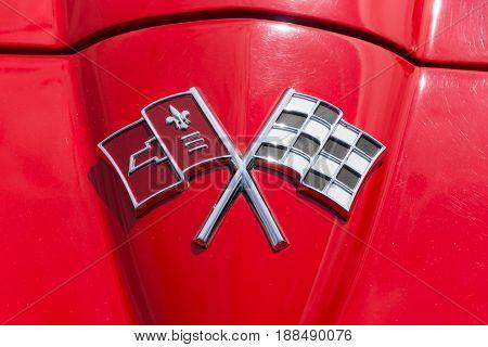BERLIN GERMANY - MAY 17 2014: Emblem sports car Chevrolet Corvette Sting Ray (C2). 27th Oldtimer Day Berlin - Brandenburg