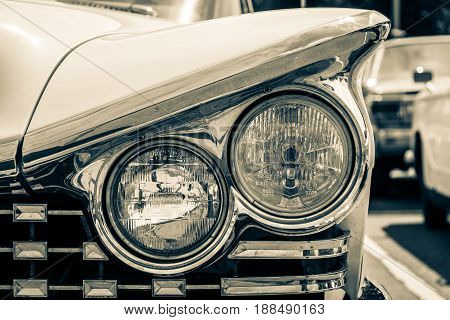BERLIN GERMANY - MAY 17 2014: Headlamp of the Buick LeSabre (First generation). Stylization. Toning. 27th Oldtimer Day Berlin - Brandenburg