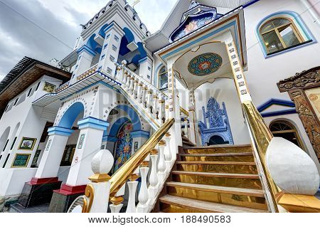 Wide angle view on Izmailovsky Kremlin rebuild imperial manor of XVII century. White stone manor architecture with classic traditional Russian ornaments painting wooden elements of blue golden colors